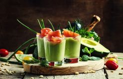 Appetizer with smoked salmon and avocado mousse, served in glass royalty free stock image