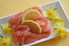 Appetizer with smoked salmon. And decoration with mini Daffodils Royalty Free Stock Image