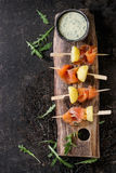 Appetizer with smoked salmon and potatoes Stock Image