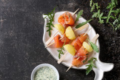 Appetizer with smoked salmon and potatoes Stock Photos
