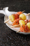 Appetizer with smoked salmon and potatoes Royalty Free Stock Image