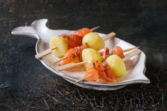 Appetizer with smoked salmon and potatoes Royalty Free Stock Images