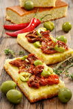 Appetizer of sun-dried tomatoes, olives and thyme. Stock Images