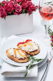 Appetizer, toast with cheese, pepper and rosemary Stock Images
