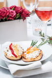 Appetizer, toast with cheese, pepper and rosemary Stock Photos