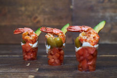 Appetizer with tomatoes, shrimps and olives in glass Royalty Free Stock Image