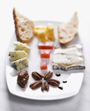 Appetizer Tray. With a selection of breads, cheeses, fruits and nuts. Vertical shot Stock Image