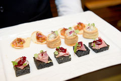 Appetizer and white plate Stock Photos