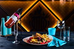 Appetizer and wine for a romantic evening in a restaurant royalty free stock images