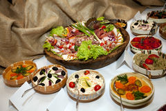 Appetizers. Some appetizers on a wood plates Royalty Free Stock Images
