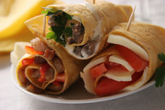 Appetizers. Tortillas with fried pork and pepper, mozzarella and tomatoes, sprats and sauce with parsley Stock Images