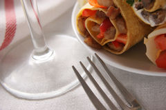 Appetizers. Plate with appetizers on a white table-cloth Stock Photos