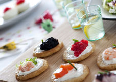 Appetizers. With caviar, salmon, shrimps Stock Image