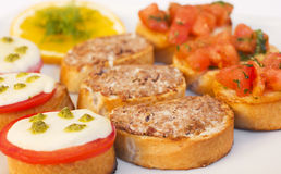 Appetizers. A plate of different kinds of appetizers royalty free stock photos
