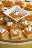 Appetizers. Delicious appetizers with smoked salmon and dille sauce royalty free stock photos