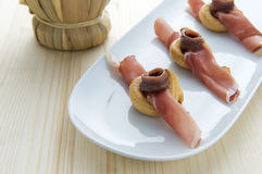Appetizers. Anchovy, speck and bagels, typical of the southern regions of Italy Royalty Free Stock Images