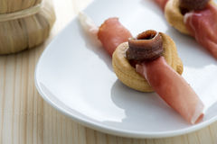 Appetizers. Anchovy, speck and bagels, typical of the southern regions of Italy Royalty Free Stock Photography