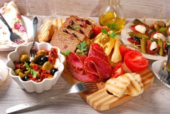 Appetizers and antipasti on wooden table Stock Images