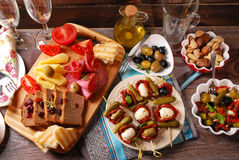 Appetizers and antipasti on wooden table Stock Photo