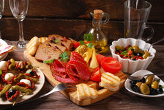 Appetizers and antipasti on wooden table Royalty Free Stock Images