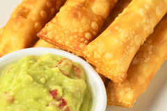 Appetizers Called Tequenos with Guacamole Stock Images