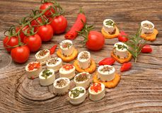 Appetizers cheese and bruschetta with herbs, tomato and chilli peppers,Vegetarian starter appetizer Royalty Free Stock Image