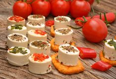 Appetizers cheese and bruschetta with herbs, tomato and chilli peppers Stock Image