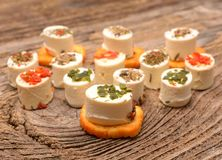 Appetizers cheese and bruschetta with herbs Stock Photo
