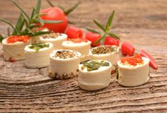 Appetizers cheese with herbs, red peppers and tomato Royalty Free Stock Images