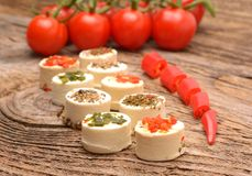 Appetizers cheese with herbs, red peppers and tomato Royalty Free Stock Image