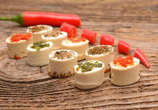 Appetizers cheese with herbs and red peppers Stock Photos