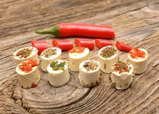 Appetizers cheese with herbs and red peppers Royalty Free Stock Photos
