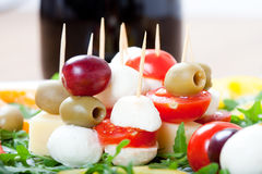 Appetizers with cheese, mozzarella, olive, fresh rocket, grapes, Stock Images