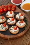 Appetizers with cheese spread and tomato on wooden background Royalty Free Stock Images