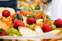 Appetizers close up. Close up of an appetizer tray with crackers, cheese and berries Royalty Free Stock Images