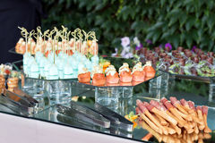 Appetizers, finger food, party food, sliders. Canape, tapas. Served table at summer terrace cafe. Catering service stock images