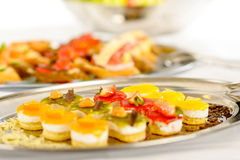 Appetizers mini desserts on catering buffet plate. Appetizers mini desserts on catering buffet white tablecloth Royalty Free Stock Image