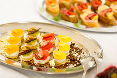Appetizers mini desserts on catering buffet plate Royalty Free Stock Photos