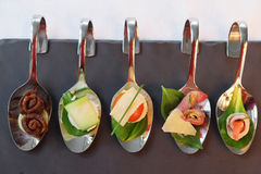 Appetizers  on party spoons Stock Photo