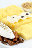 Appetizers with polenta, eggs, parmigiano Stock Images