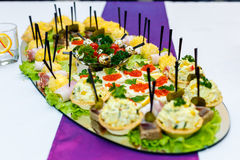 Appetizers with red caviar at the banquet table Stock Photo