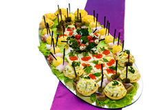 Appetizers with red caviar at the banquet table Stock Image