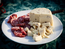 Appetizers, salami and cheese. Some sliced thin slices of salami and little pieces of cheese, Sicily, Italy Stock Photography