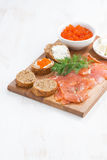 Appetizers - salted salmon, red caviar, toast and cream cheese Stock Image