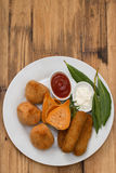 Appetizers with sauces on white plate Royalty Free Stock Photography