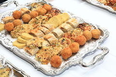 Appetizers on Silver Platter. Assortment of cold appetizers on an ornate silver platter Stock Photo
