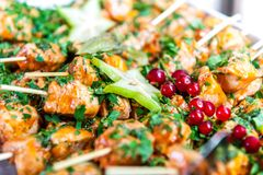 Appetizers on skewers with chicken and star fruits royalty free stock photography