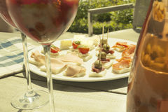 Appetizers on a summer day with wine Royalty Free Stock Images