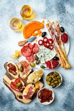 Appetizers table with antipasti snacks and wine in glasses. Bruschetta or authentic traditional spanish tapas set royalty free stock images