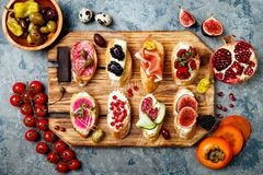 Appetizers table with italian antipasti snacks. Brushetta or authentic traditional spanish tapas set royalty free stock photos